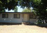 Foreclosed Home in D ST, Pinehurst, ID - 83850