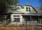 Foreclosed Home en E SPRING ST, El Dorado Springs, MO - 64744