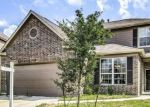 Foreclosed Home in REDBUD POINT LN, Houston, TX - 77049