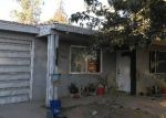 Foreclosed Home en HENLEY ST, Bakersfield, CA - 93307