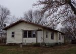 Foreclosed Home en MAIN ST, Henrietta, MO - 64036