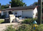 Foreclosed Home en N HARTTS DR, Tampa, FL - 33617