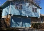 Foreclosed Home en HARLAN CT, Arvada, CO - 80003