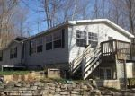 Foreclosed Home in S NELLSVILLE RD, Houghton Lake, MI - 48629