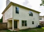 Foreclosed Home in CYPRESSWOOD TRCE, Spring, TX - 77373