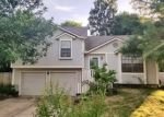 Foreclosed Home en HUNTINGTON DR S, Greenwood, MO - 64034