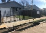 Foreclosed Home en DEFIANCE AVE, Los Angeles, CA - 90002