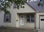 Foreclosed Home en S CLAREMONT AVE, Independence, MO - 64052