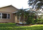 Foreclosed Home in TIERRA DEL FUEGO CIR, Punta Gorda, FL - 33983