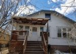 Foreclosed Home en THOMES AVE, Cheyenne, WY - 82001