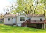 Foreclosed Home en NE 73RD TER, Kansas City, MO - 64118