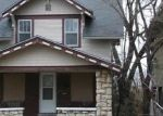 Foreclosed Home en OLIVE ST, Kansas City, MO - 64130