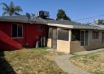 Foreclosed Home en E SIMPSON AVE, Fresno, CA - 93703