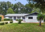 Foreclosed Home en HOLMES DR, Orlando, FL - 32808
