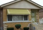 Foreclosed Home in S CORNELL AVE, Chicago, IL - 60617