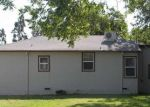 Foreclosed Home en KINGSLEY AVE, Stockton, CA - 95203