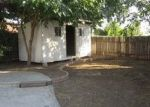 Foreclosed Home in OLYMPIA DR, Bakersfield, CA - 93309