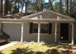 Foreclosed Home en W POCAHONTAS AVE, Tampa, FL - 33615