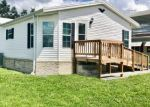 Foreclosed Home en NORTHSHORE DR, Polk City, FL - 33868