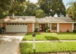 Foreclosed Home en RAMBLEBROOK LN, Tampa, FL - 33624