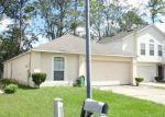 Foreclosed Home en WILEY OAKS LN, Jacksonville, FL - 32210