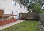 Foreclosed Home en HUNTERS LN, Huntington Station, NY - 11746