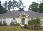 Foreclosed Home in RAEMOND LN, Palm Coast, FL - 32164