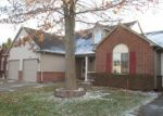 Foreclosed Home en REDMAPLE LN, Brighton, MI - 48116