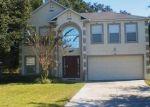 Foreclosed Home en DAYBREAK DR, Fruitland Park, FL - 34731