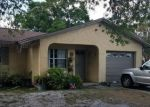 Foreclosed Home en COOKMAN DR, Tampa, FL - 33619