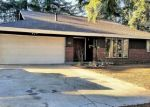 Foreclosed Home en 140TH AVE SE, Renton, WA - 98058