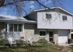 Foreclosed Home en W 57TH AVE, Arvada, CO - 80002