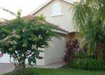Foreclosed Home in SW MUNJACK CIR, Port Saint Lucie, FL - 34986