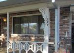 Foreclosed Home en W 11TH ST, Merced, CA - 95341