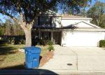 Foreclosed Home en ASHFORD WOOD CT E, Jacksonville, FL - 32218