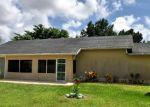 Foreclosed Home en SE ELKHART TER, Port Saint Lucie, FL - 34952