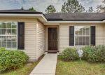 Foreclosed Home en STEAMBOAT SPRINGS DR E, Jacksonville, FL - 32210