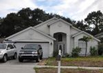 Foreclosed Home en WOODFIELD OAKS DR, Apopka, FL - 32703