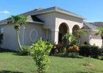 Foreclosed Home en DAKOTA ROCK DR, Ruskin, FL - 33570
