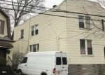 Foreclosed Home in COOPER AVE, Ridgewood, NY - 11385