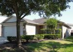 Foreclosed Home in BLUFF CANYON WAY, Katy, TX - 77450