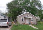 Foreclosed Home en S PARK ST, El Dorado Springs, MO - 64744