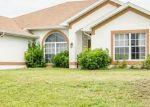 Foreclosed Home en NE 23RD ST, Cape Coral, FL - 33909