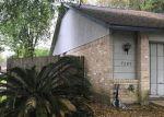Foreclosed Home en NAVIDAD RD, Houston, TX - 77083