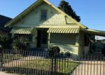 Foreclosed Home en W 51ST ST, Los Angeles, CA - 90037