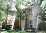 Foreclosed Home en VILLAGE SPRINGS DR, Kingwood, TX - 77339