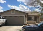 Foreclosed Home en W RAYMOND ST, Phoenix, AZ - 85043