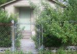 Foreclosed Home en N BROOKS ST, Tampa, FL - 33604