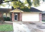 Foreclosed Home en COVERED BRIDGE ST, Houston, TX - 77075