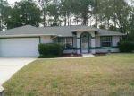 Foreclosed Home en WHETSTONE LN, Palm Coast, FL - 32164